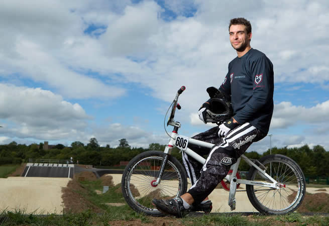 Rob Reid relaxes on his BMX