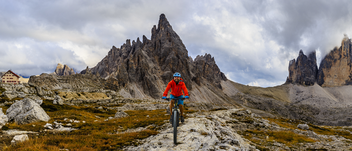A rider descends an alpine trail
